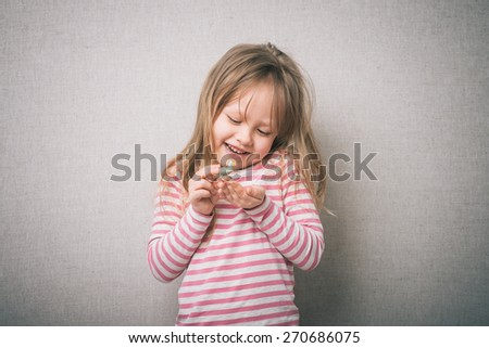little girl with rubber ducks - stock photo