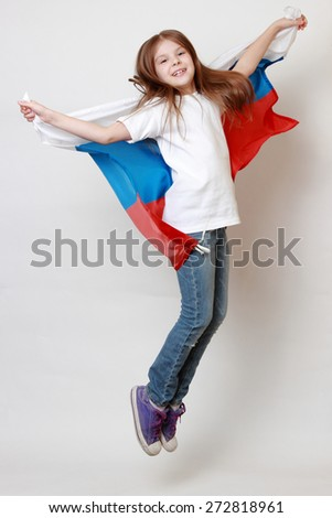 Little girl with russian flag - stock photo