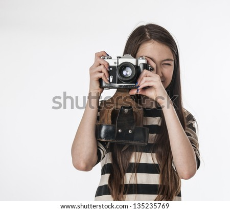 Little girl with russian  photo camera Zenit - stock photo