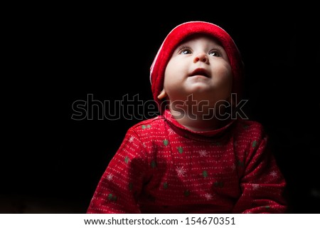 little girl with Santa costume - stock photo