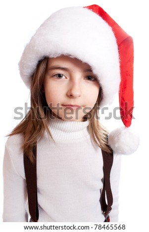Little girl with santa's hat - stock photo