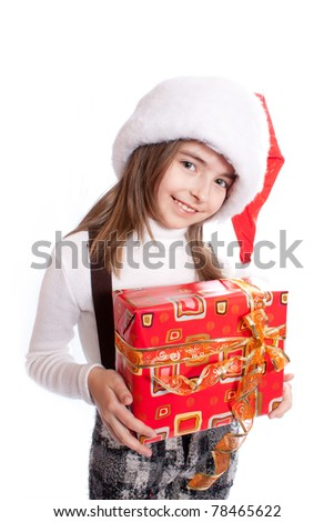 Little girl with santa's hat and gift holding