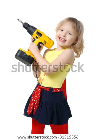 Little girl with screwdriver in hands on a grey background - stock photo