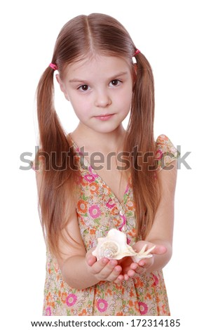 little girl with sea shell
