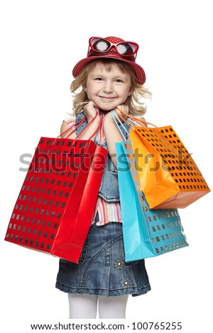 Little girl with shopping bags over white