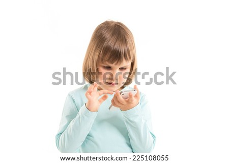 little girl with smartphone on white background