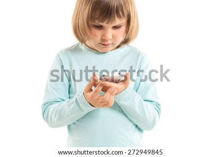little girl with smartphone on white background - stock photo