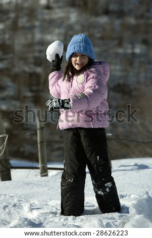 little girl with snowball - stock photo