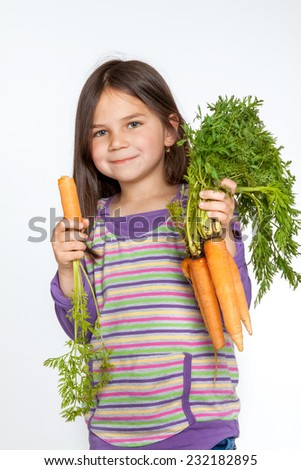 Little girl with sort of vegetables