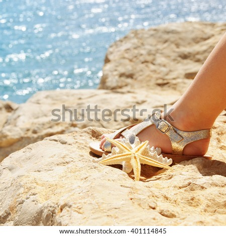 Little girl with starfish. Travel concept - stock photo