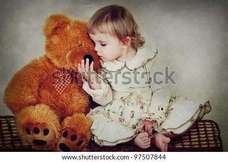 little girl with teddy bear - stock photo