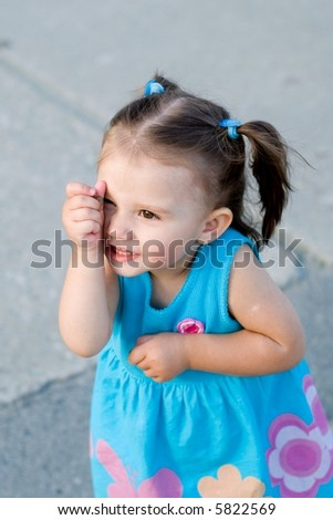 little girl with the coin - stock photo