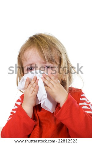 Little girl with the flu blowing her nose - isolated - stock photo