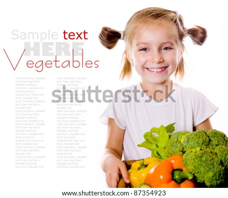 Little girl with the vegetables  - healthy food concept - stock photo