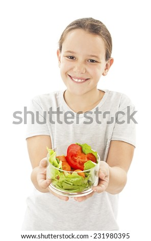 Little girl with the vegetables - healthy food concept.  Isolated on white background  - stock photo