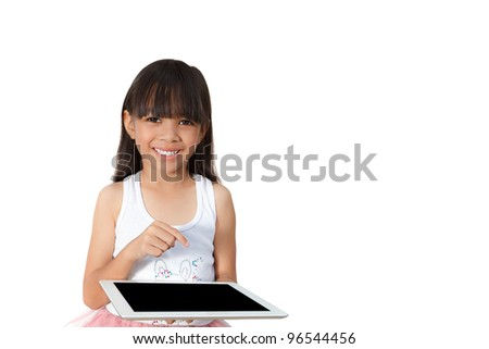 Little girl with touch pad computer, Isolated on white - stock photo