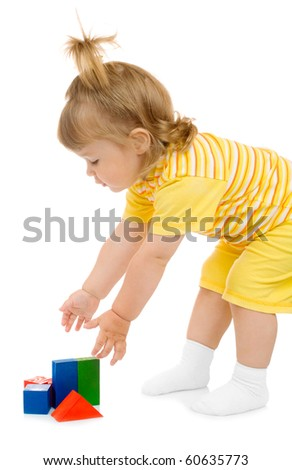 Little girl with toy cubes isolated