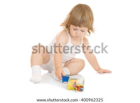Little girl with toy cubes isolated on white - stock photo