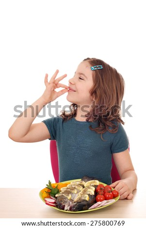 little girl with trout and ok hand sign - stock photo