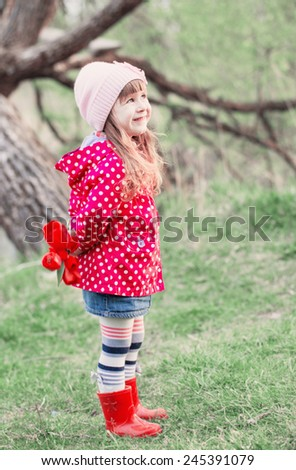 little girl with tulips outdoor - stock photo