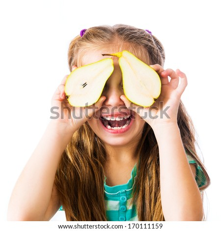 little girl with two halves of pears on a white background - stock photo