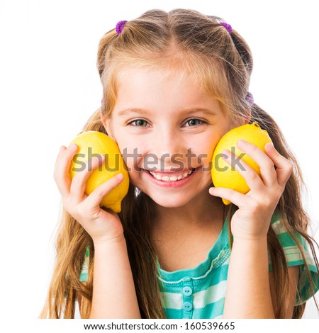 little girl with two lemons isolated on white background - stock photo