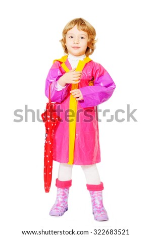 little girl with umbrella over the white