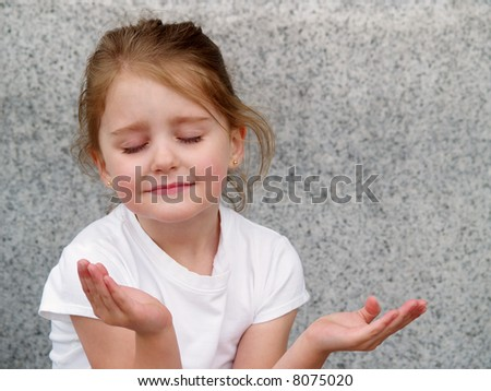 little girl with upturned hands as in prayer or meditation - stock photo