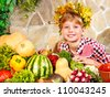 Little girl with vegetable on kitchen at home. - stock photo