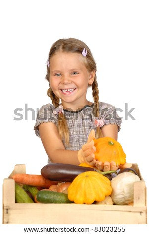 Little girl with vegetables. Isolated over white