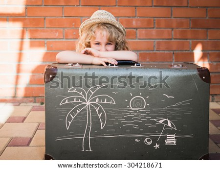 Little girl with vintage suitcase. Travel concept - stock photo