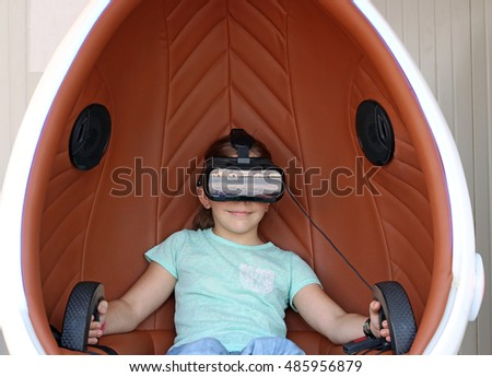 little girl with virtual reality headset play video game