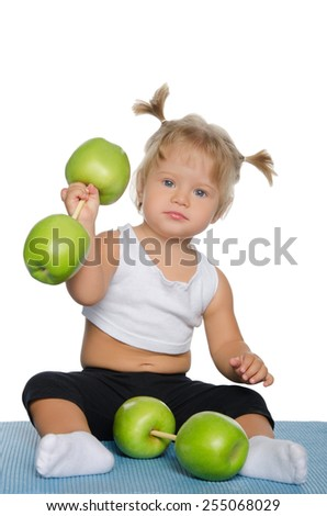 Little girl with weights of green apples isolated on white