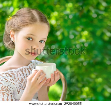 Little girl with white cup outdoor.  People, children, tea, traditions and time management concept. Vintage style - stock photo