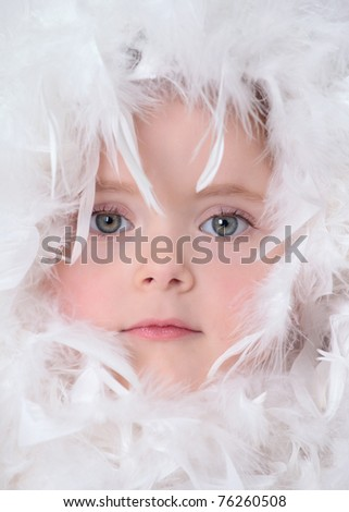 Little girl with white feathers - stock photo