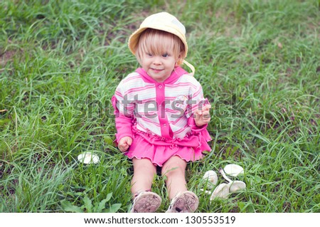 Little girl with white mushrooms