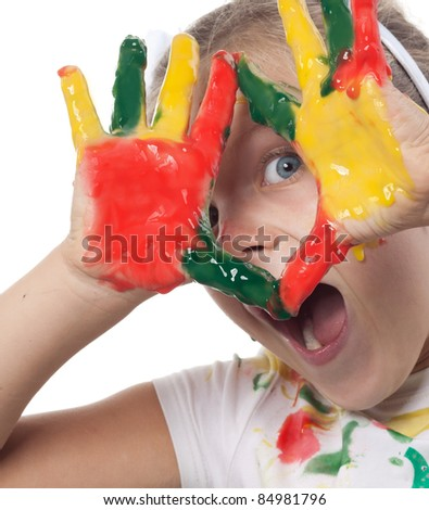 little girl with with hand painted in colorful paints - stock photo