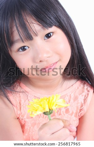 Little girl with yellow flower - stock photo
