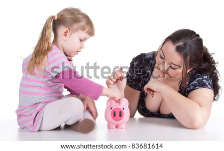 little girl with young woman and pink piggy bank