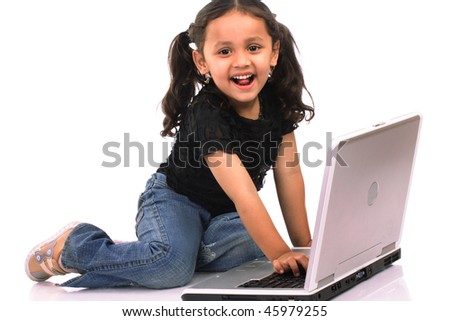 Little girl working on computer - stock photo