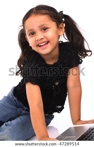 Little girl working on laptop - stock photo