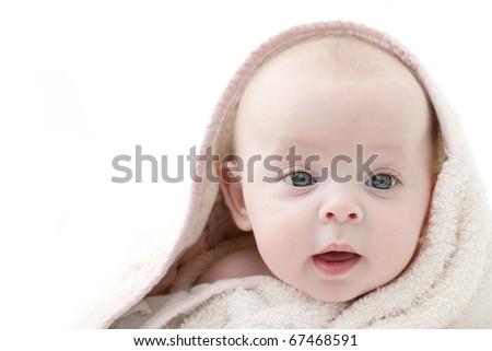 Little girl wrapped in her bathrobe. - stock photo