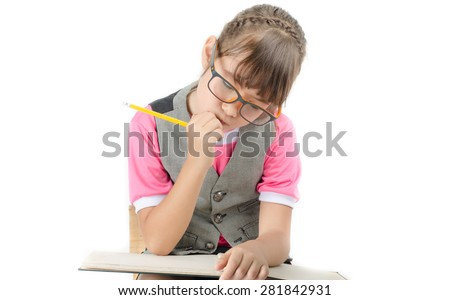 Little girl writhing with notebook and penceil on white background