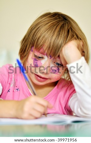 Little girl writing - stock photo