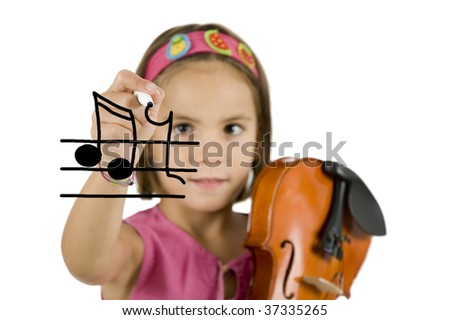 little girl writing with a pen and holding a violin isolated on white background - stock photo