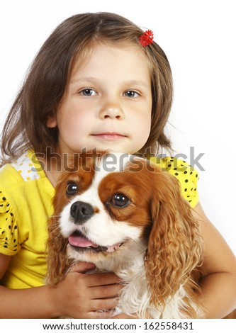 little girl 5 years old and the dog isolated on a white background - stock photo