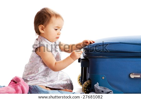 Little girl zipping the suitcase, isolated - stock photo