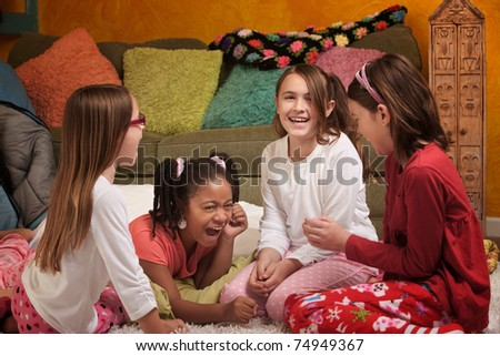Little Girls at a sleepover laugh together - stock photo