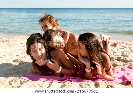 little girls at the beach - stock photo