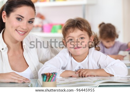 Little girls drawing in class - stock photo